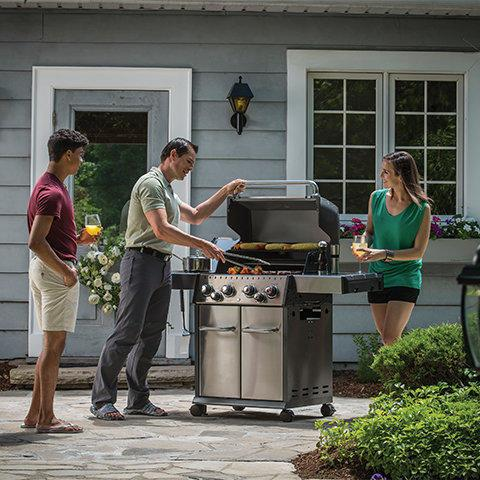 People grilling with a Broil King grill
